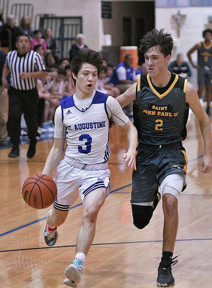 Esteban Pedraza scored 15 points off the bench as St. Augustine beat John Paul II Wednesday. Photo: Cuate Santos /Laredo Morning Times / Laredo Morning Times