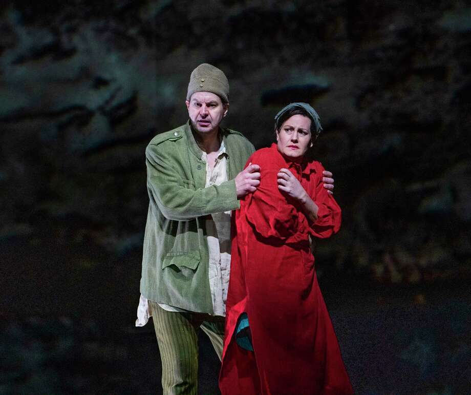 """Peter Mattei and Elza van den Heever in Alban Berg's """"Wozzeck,"""" set in the lead-up to World War I, at the Metropolitan Opera in New York, Dec. 18, 2019. Artist William Kentridge's arresting animations heighten Berg's searingly honest work about a delusional soldier, The New York Times critic Anthony Tommasini says. (Sara Krulwich/The New York Times) Photo: SARA KRULWICH / Sara Krulwich/New York Times / NYTNS"""