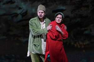 "Peter Mattei and Elza van den Heever in Alban Berg's ""Wozzeck,"" set in the lead-up to World War I, at the Metropolitan Opera in New York, Dec. 18, 2019. Artist William Kentridge's arresting animations heighten Berg's searingly honest work about a delusional soldier, The New York Times critic Anthony Tommasini says. (Sara Krulwich/The New York Times)"