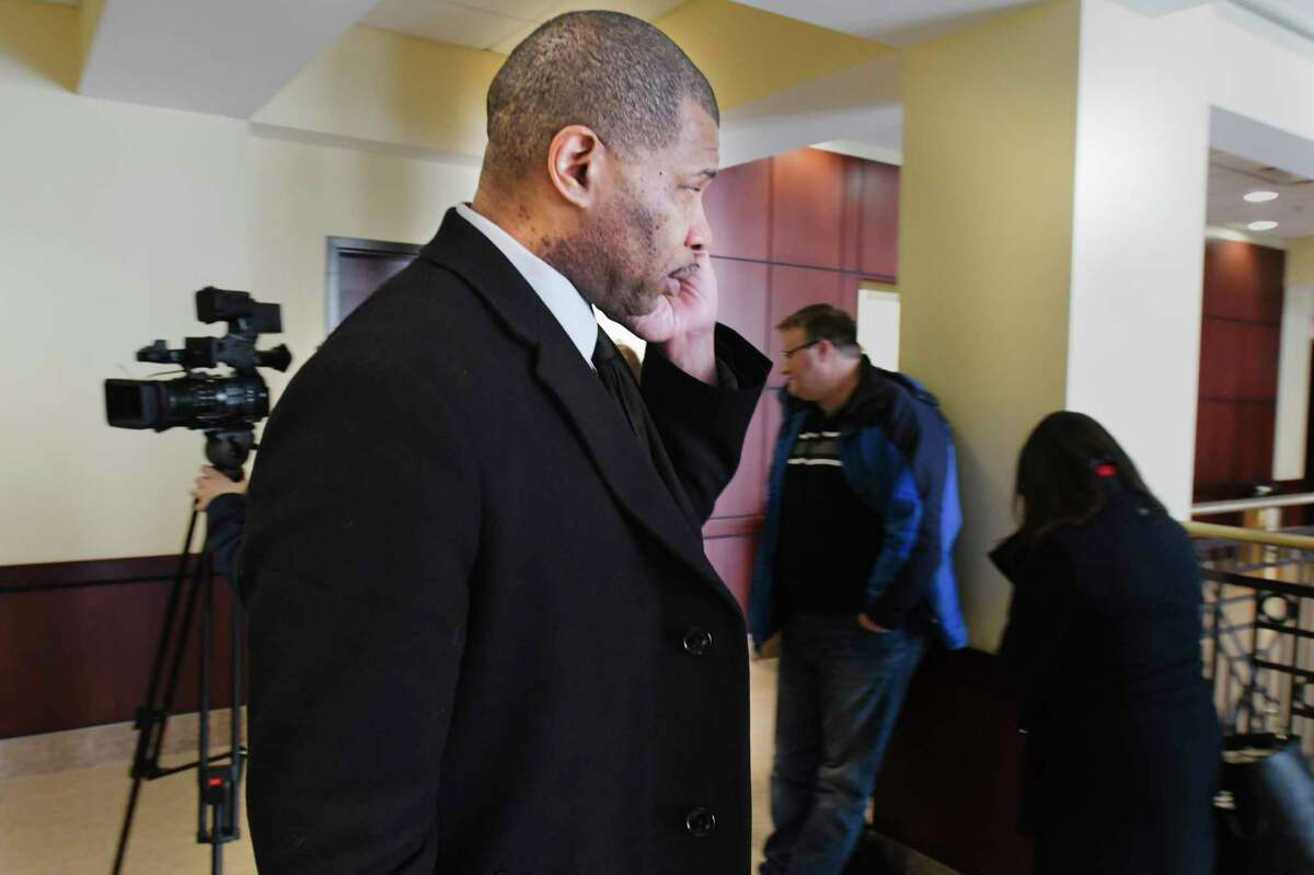 Brian Angelo, known as DJ Iroc, walks out of court on Thursday, Jan. 9, 2020, in Albany, N.Y. Angelo and his attorney were in court to ask for the judge to order that his lawyers be allowed to examine a local radio station where it is alleged that Angelo assaulted a victim. (Paul Buckowski/Times Union)