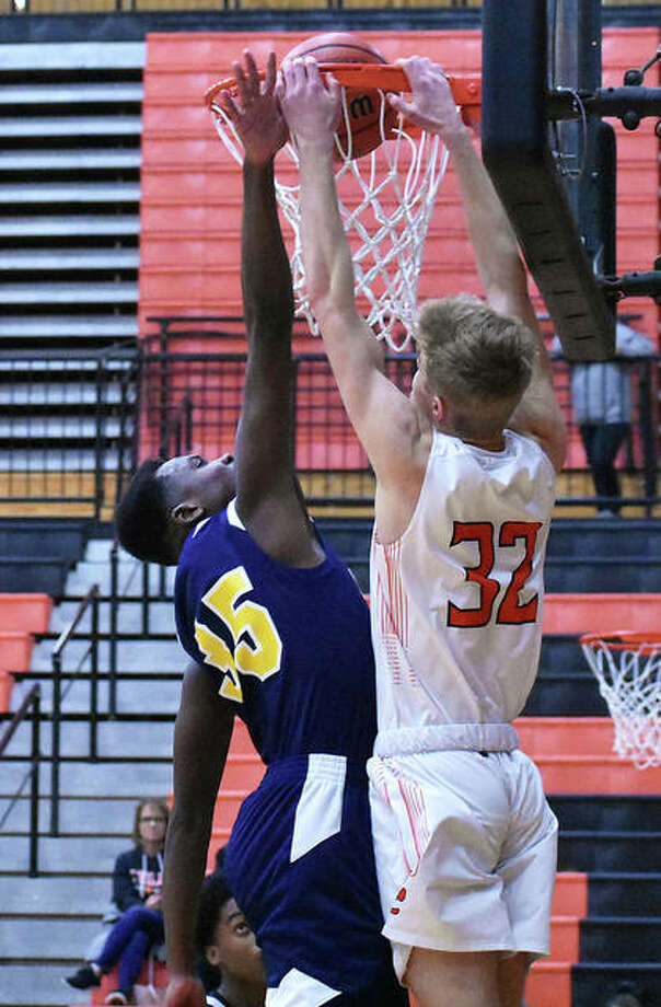 Edwardsville forward Jack Nafziger throws down a two-handed dunk in the third quarter against Cleveland. Photo: Matt Kamp|The Intelligencer