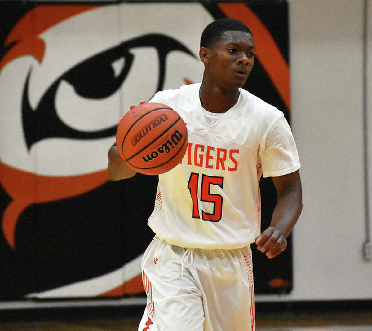 Edwardsville guard Willie Thomas brings the ball up the court in the fourth quarter.
