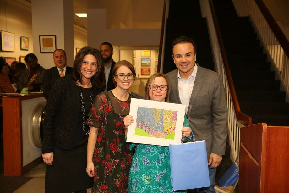 Shelton resident Molly Hauser, next to Bridgeport Mayor Joe Ganim, shows off her artistic creation that is featured in the new 2020 Unique Perspective calendar. Photo: Picasa / Contributed Photo / Connecticut Post