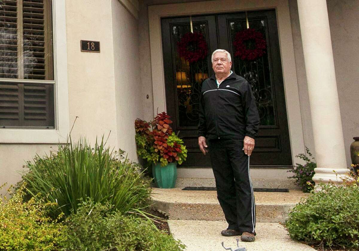 Homeowner and USAA insurance customer Larry Sultenfuss' poses outside his home in the Dominion in San Antonio, Texas, on Dec. 10, 2019. The neighborhood was hit by a hail storm in April that damaged many homes' roofs. Months later, it's easy to spot the homes insured by USAA, according to homeowners- they're the roofs that are still compromised.