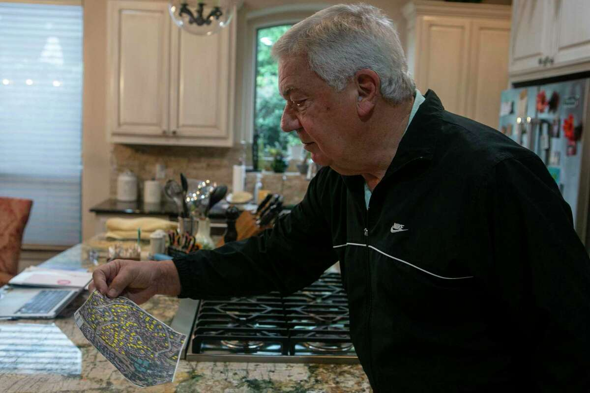 Dominion homeowner and USAA insurance customer Larry Sultenfuss' looks over a map of compromised roofs after a hail storm in his home in San Antonio, Texas, on Dec. 10, 2019. The neighborhood was hit by a hail storm in April that damaged many homes' roofs.