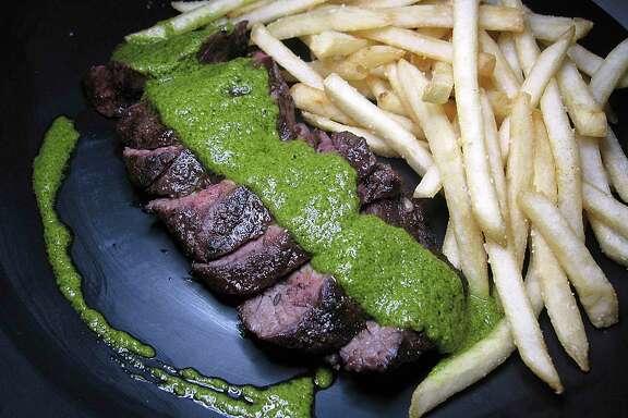 Steak frites comes with chimichurri sauce at Julia's Bistro & Bar.