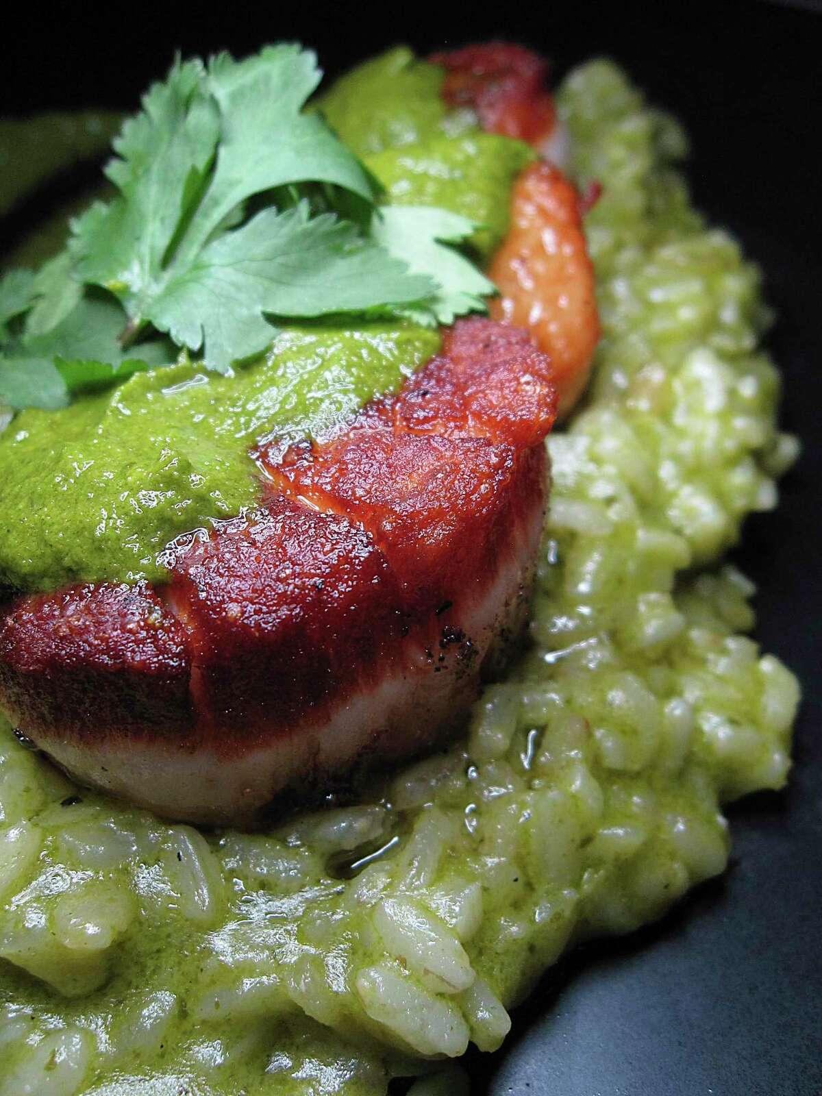 Seared scallops come with cilantro-lime risotto at Julia's Bistro & Bar.