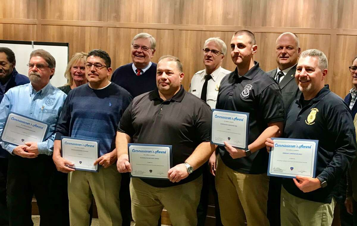 Front row from left, Ed Rondano, Angel Gonzalez, Mike Long, Chris Friel and Sgt. Chris DiCarlo. Rear row from left Milton Thomas, Sukie McFadden, Mayor David Martin, Interim Chief Thomas Wuennemann, Public Safety Director Ted Jankowsky and Tim Abbazia.
