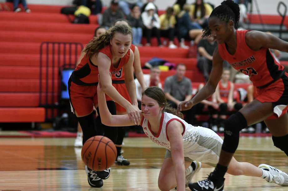 Huffman Hargrave junior Kyleigh Boyd-Smith, center, scrambles for a loose ball against a pair of Huntington defenders on a play late in the second quarter of a game at Hargrave High School on Jan. 7, 2020. Photo: Jerry Baker, Houston Chronicle / Contributor / Houston Chronicle