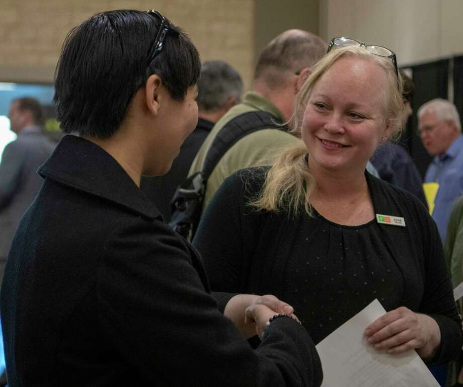 Anne Hinkle ,Holiday Inn Club Vacations recruiter, shakes hands after speaking with prospective employee Maria Barrera during the 7th annual Conroe Lake Conroe Chamber Job Fair on Tuesday, Jan 29, 2019 at the Lone Star Convention and Expo Center in Conroe. Photo: Cody Bahn, Houston Chronicle / Staff Photographer / © 2018 Houston Chronicle