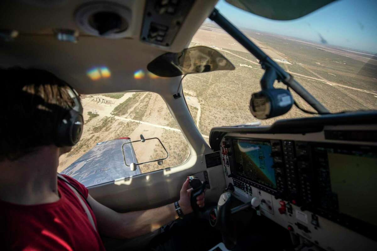 Paolo Wilczak, a scientist and the pilot of the two-seater aircraft, circles above the Permian Basin in Texas, searching for methane leaks, Nov. 4, 2019. Immense amounts of methane are escaping from oil and gas sites nationwide, worsening global warming, even as the Trump administration weakens restrictions on offenders. (Jonah M. Kessel/The New York Times)