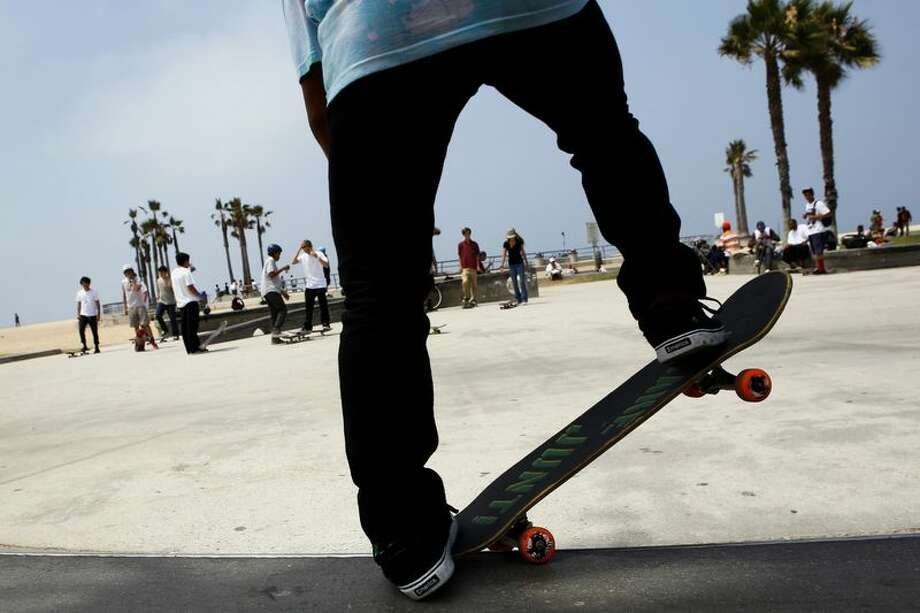 A skateboarder at Venice Beach in Los Angeles. Photo: Patrick T. Fallon/Bloomberg