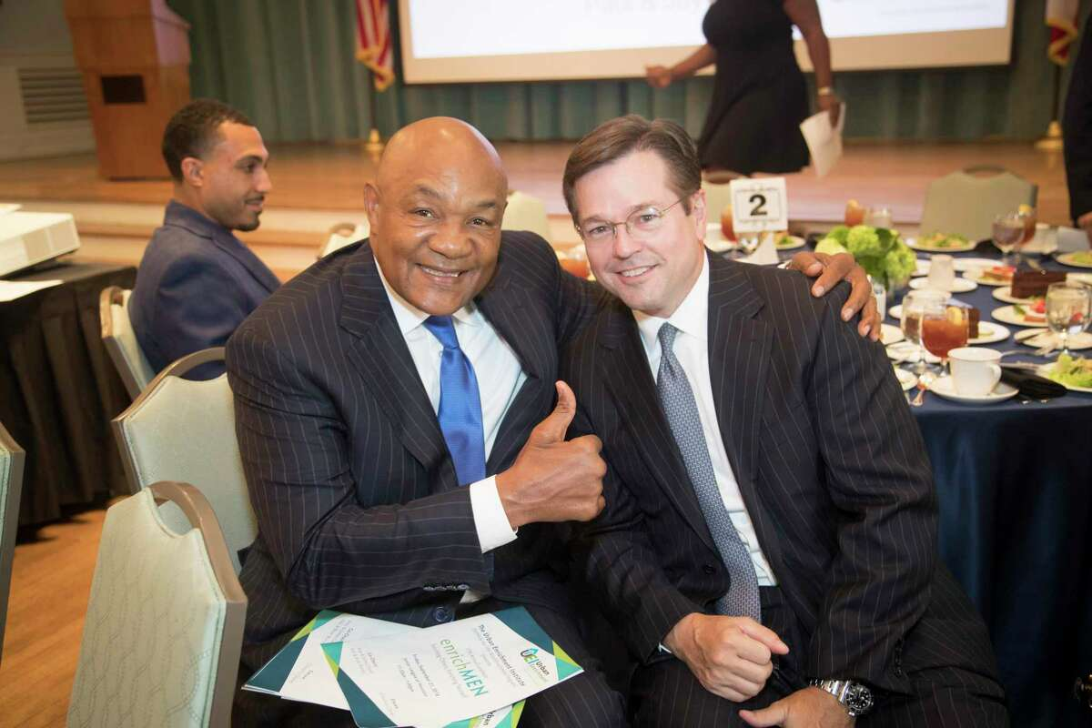 George Foreman retired boxing champion, and Champ Warren at the Urban Enrichment Institute's 17th annual luncheon themed,
