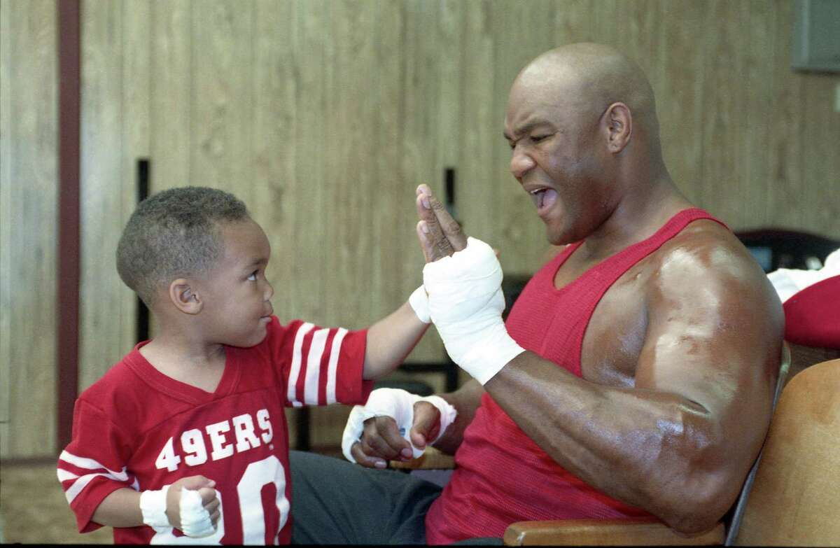 File photo from April 1, 1991 shows boxing great George Foreman sparring with this then-3-year-old son, George IV, at his East Texas Ranch.