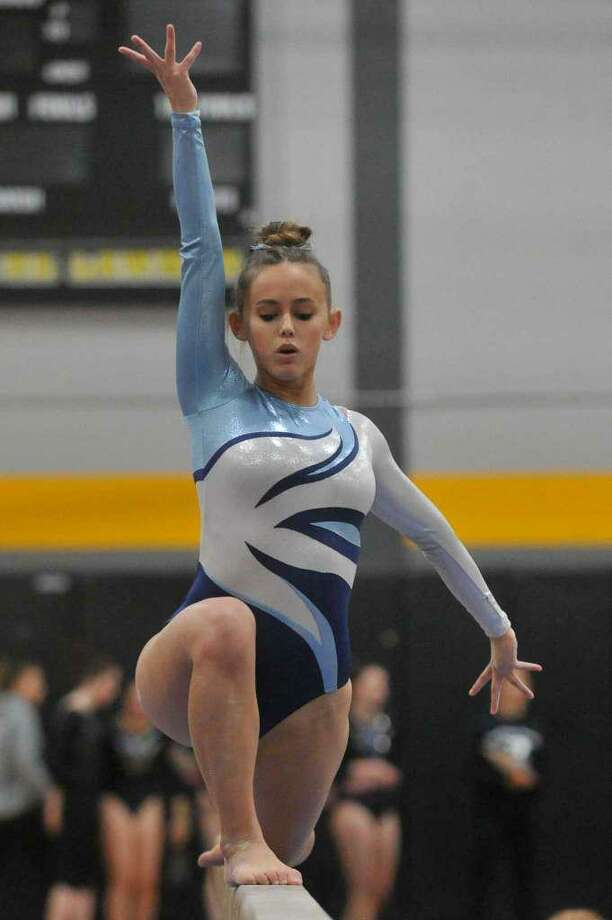 Senior Kate Ginsburg is among the top returning gymnasts for Wilton. Photo: Gregory Vasil / For Hearst Connecticut Media