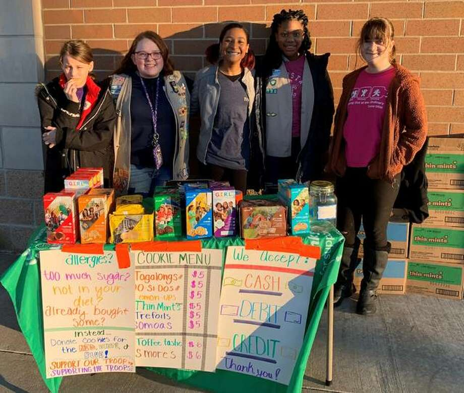 Members of Alton Girl Scouts Troop 130 — from left, KayLynn B., KayLee M., Samara H., Serena B. and Bethany N. — offer Girl Scout cookies at a recent sales booth. Local Girl Scouts are taking cookie orders through Jan. 26 and are planning cookie booths in February and March.
