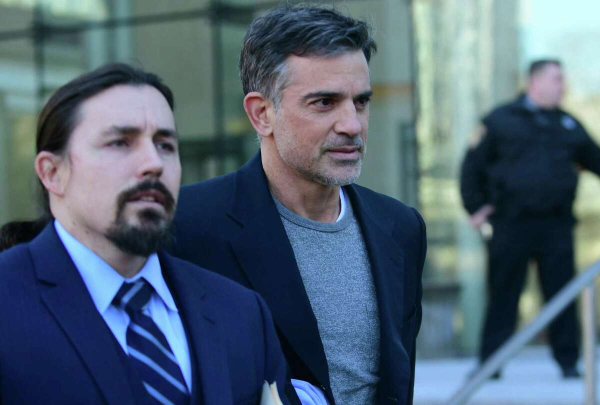 Fotis Dulos, right, exits Stamford Superior Court with his attorney Kevin Smith Thursday, January 9, 2020, after being bonded out on $6 million bond for the charge of murder of his wife Jennifer Dulos in Stamford, Conn.