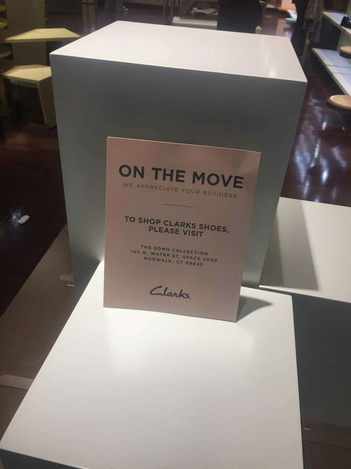 This sign in the front window of Clarks store on the fifth floor of the Stamford Town Center mall notes that the store is closing and that another Clarks store has opened at the new SoNo Collection mall in Norwalk, Conn.