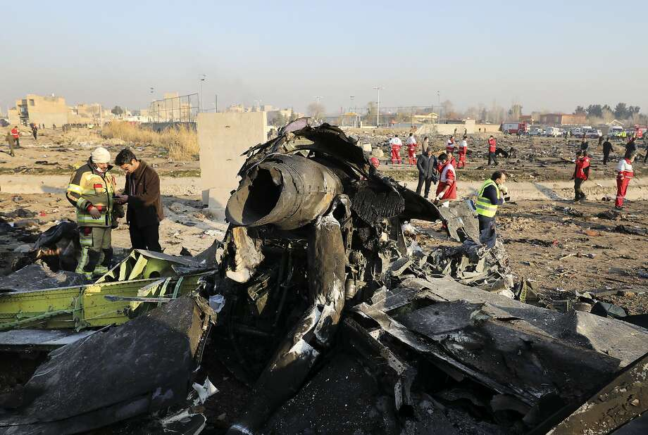 The jet crash site is located in a wide field of debris scattered across farmland. Evidence suggests an Iranian anti-aircraft missile downed the Ukraine jetliner. Photo: Ebrahim Noroozi / Associated Press