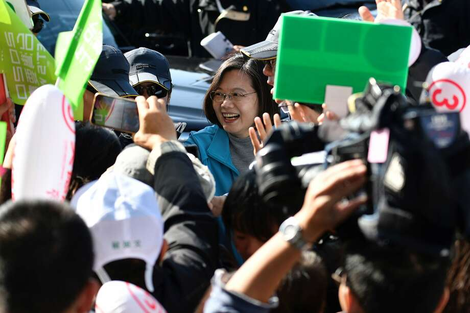 President Tsai Ing-Wen (center) is greeted by supporters as she campaigns in Taoyuan ahead of Saturday's elections. Photo: Sam Yeh / AFP / Getty Images