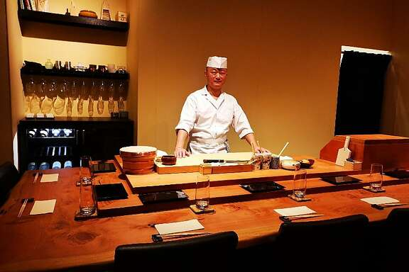 Jason Zhan stands behind the sushi bar at his nine-seat omakase restaurant Sushi Shin,�312 Arguello St., Redwood City.