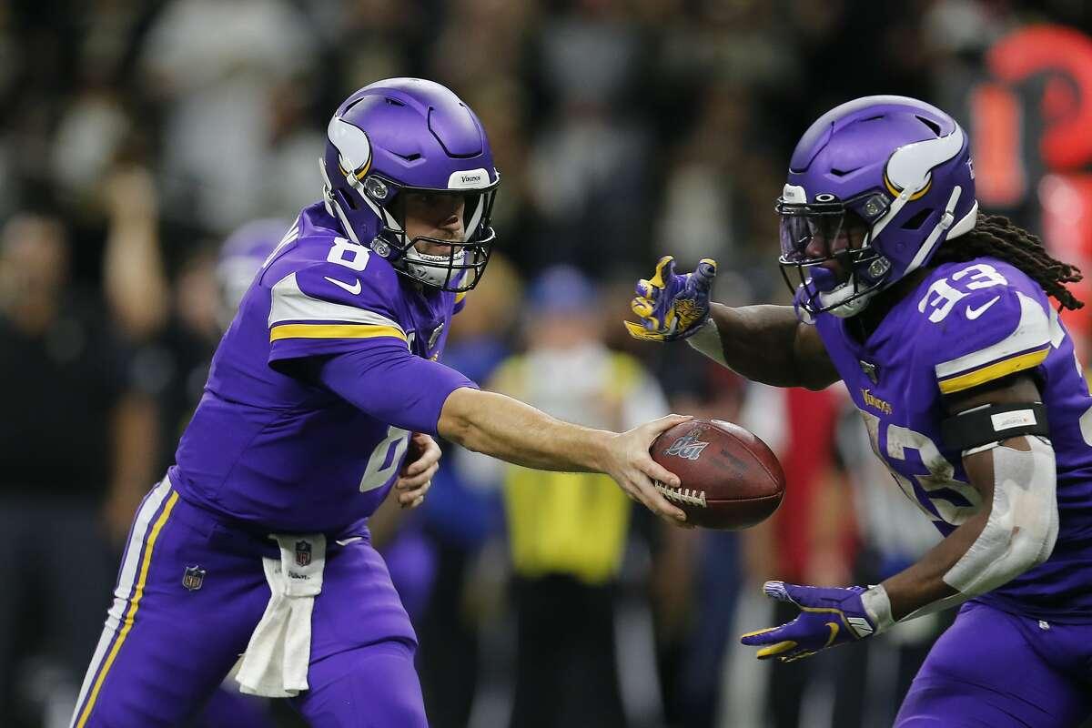 Minnesota Vikings quarterback Kirk Cousins (8) hands off to running back Dalvin Cook (33) during overtime of an NFL wild-card playoff football game, Sunday, Jan. 5, 2020, in New Orleans. The Vikings won 26-20. (AP Photo/Brett Duke)