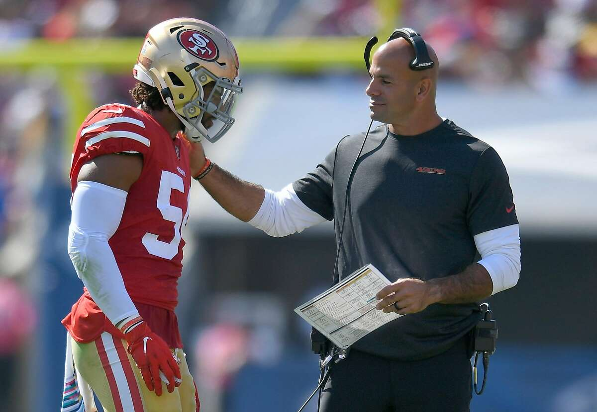 LOS ANGELES, CA - OCTOBER 13: Fred Warner #54 of the San Francisco 49ers talks with defensive coordinator Robert Saleh while playing the Los Angeles Rams at Los Angeles Memorial Coliseum on October 13, 2019 in Los Angeles, California. ~~