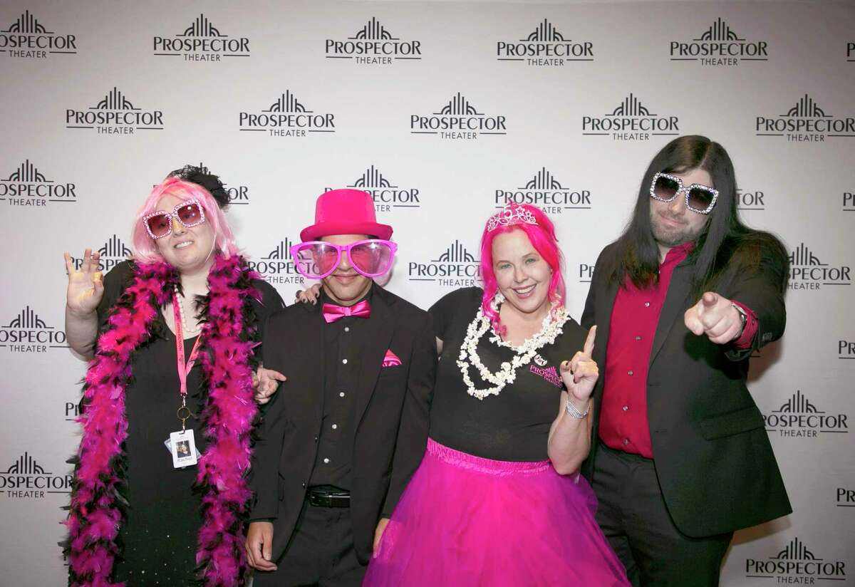 At the Prospector Theater's fifth anniversary party, Prospects Rachel Wise, Thomas DiVittorio, and lead guitarist Ryan Carnage, from left to right, wore pink along with theater owner and founder Valerie Jensen, second from right.