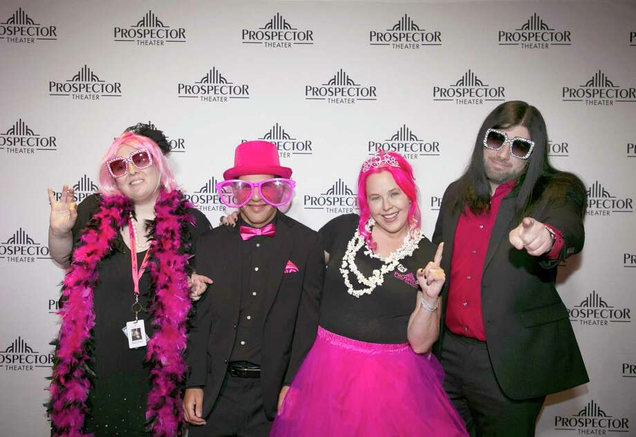 At the Prospector Theater's fifth anniversary party, Prospects Rachel Wise, Thomas DiVittorio, and lead guitarist Ryan Carnage, from left to right, wore pink along with theater owner and founder Valerie Jensen, second from right. Photo: Contributed Photo