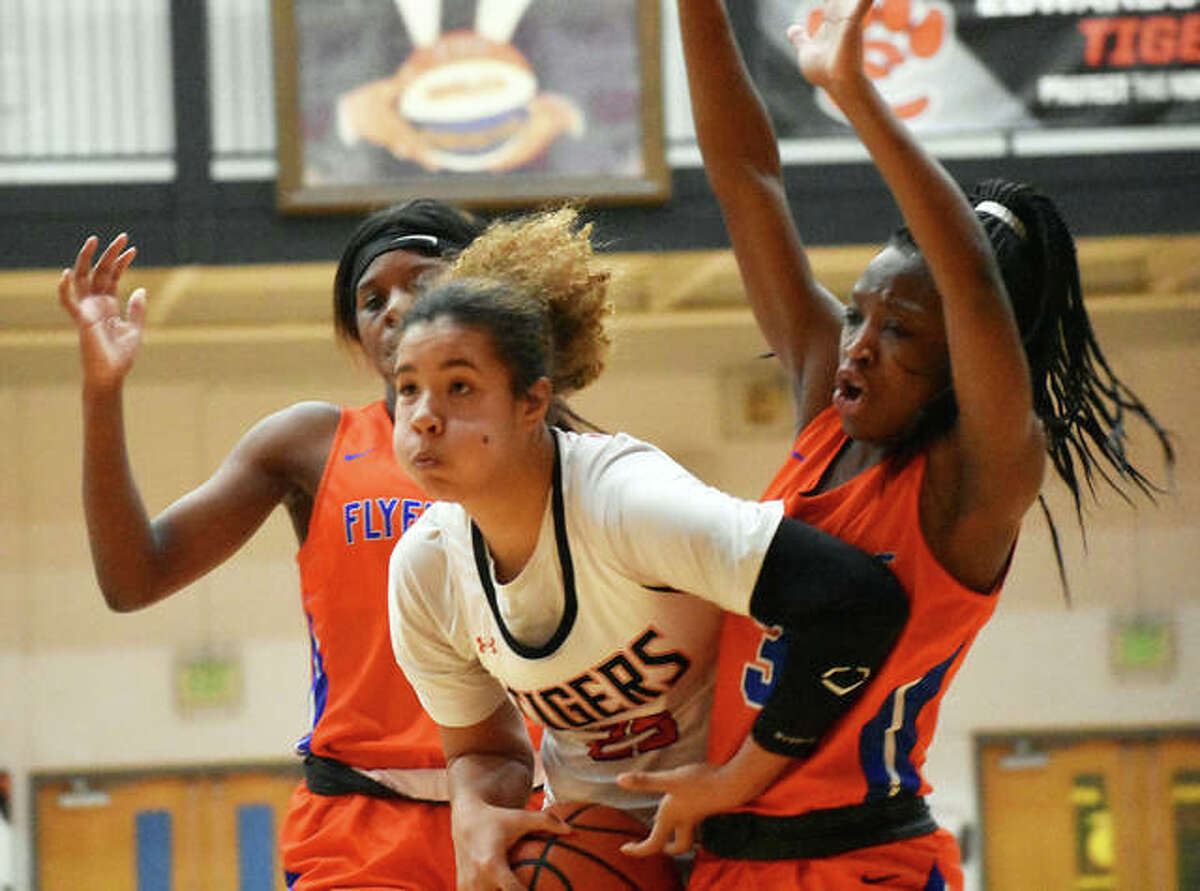 Edwardsville forward Sydney Harris, center, splits the defense and heads to the basket against East St. Louis on Tuesday inside Lucco-Jackson Gymnasium.