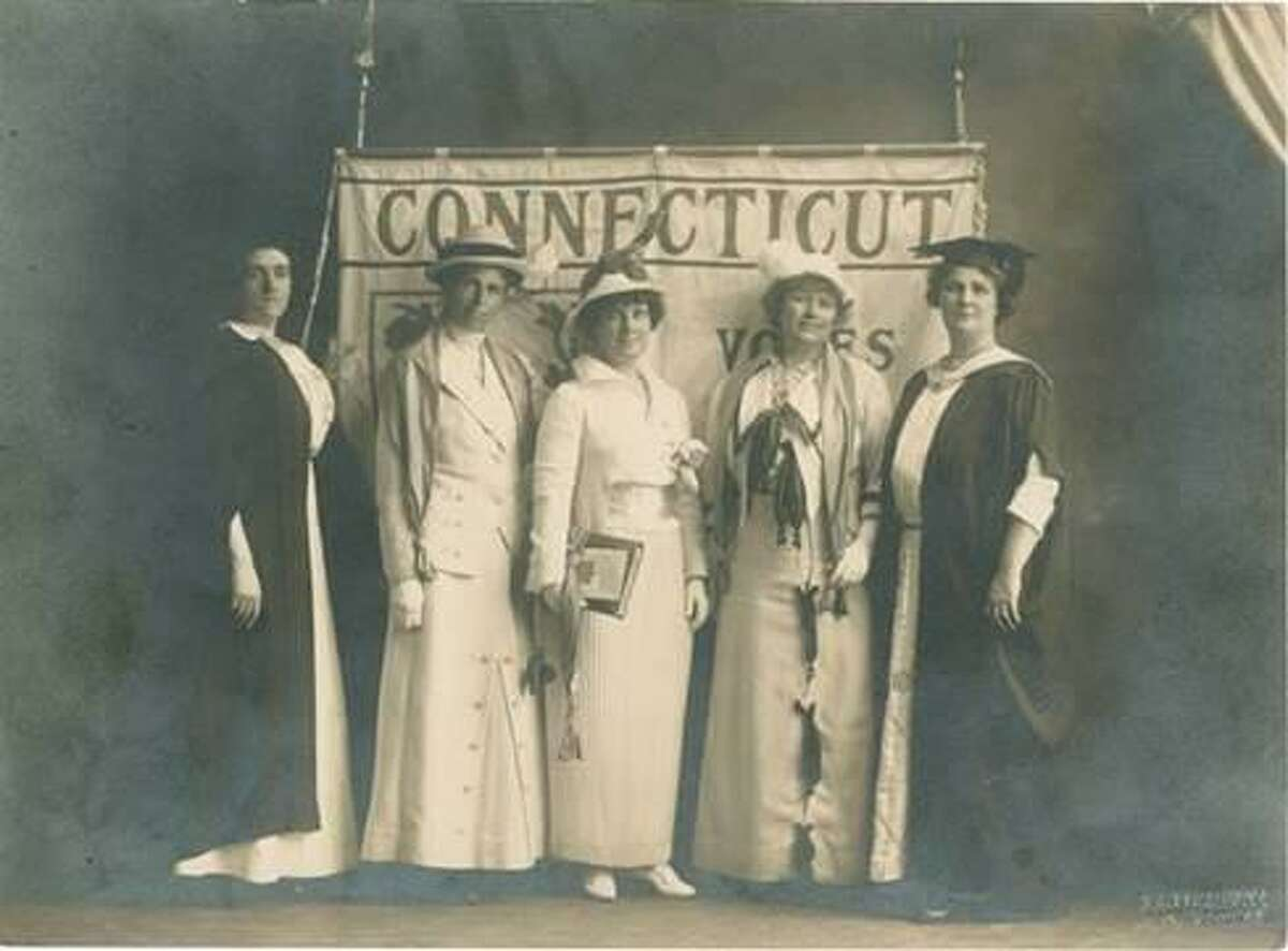 Dr. Valeria Parker, of Greenwich, and Helena Hill Weed, of Norwalk, stand at far left and right in academic robes. Grace Gallatin Seton, of Greenwich, stands in the center.