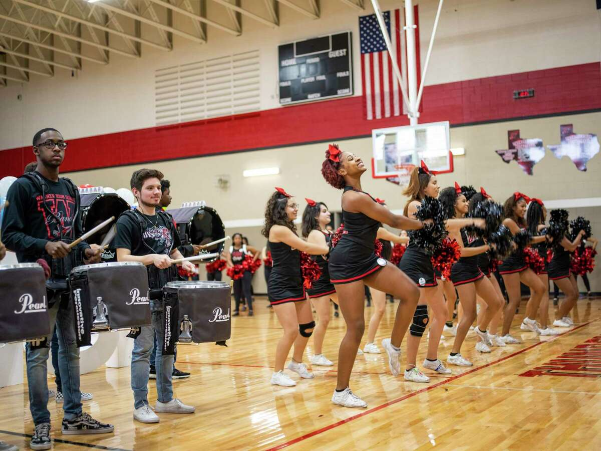 The drumline and cheerleaders of Karen Wagner High School perform during a pep rally Thursday celebrating that 100 percent of the more than 400 seniors have signed up for Alamo Promise, the free tuition program launched this year by the Alamo Colleges.
