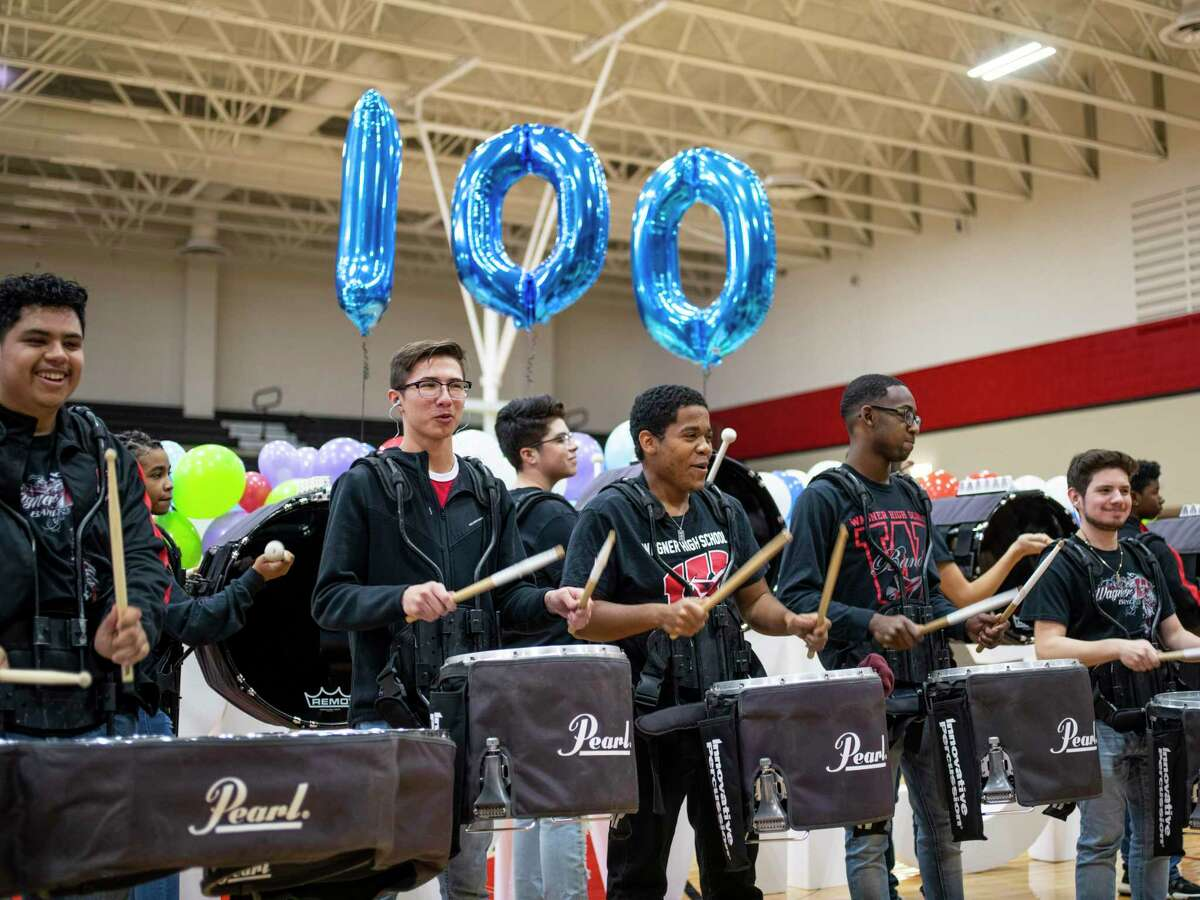 The drumline at Karen Wagner High School play during a pep rally Thursday.