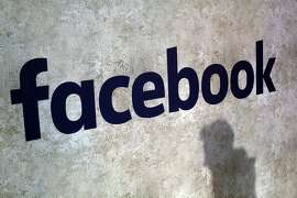 FILE - This Jan. 17, 2017, file photo shows a Facebook logo at Station F in Paris. Facebook has decided not to limit how political ads can be targeted to specific groups of people, as its main digital-ad rival Google did in November 2019 to fight misinformation. Neither will it ban political ads outright, as Twitter has done. And it still won't fact check them, as it's faced pressure to do. (AP Photo/Thibault Camus, File)