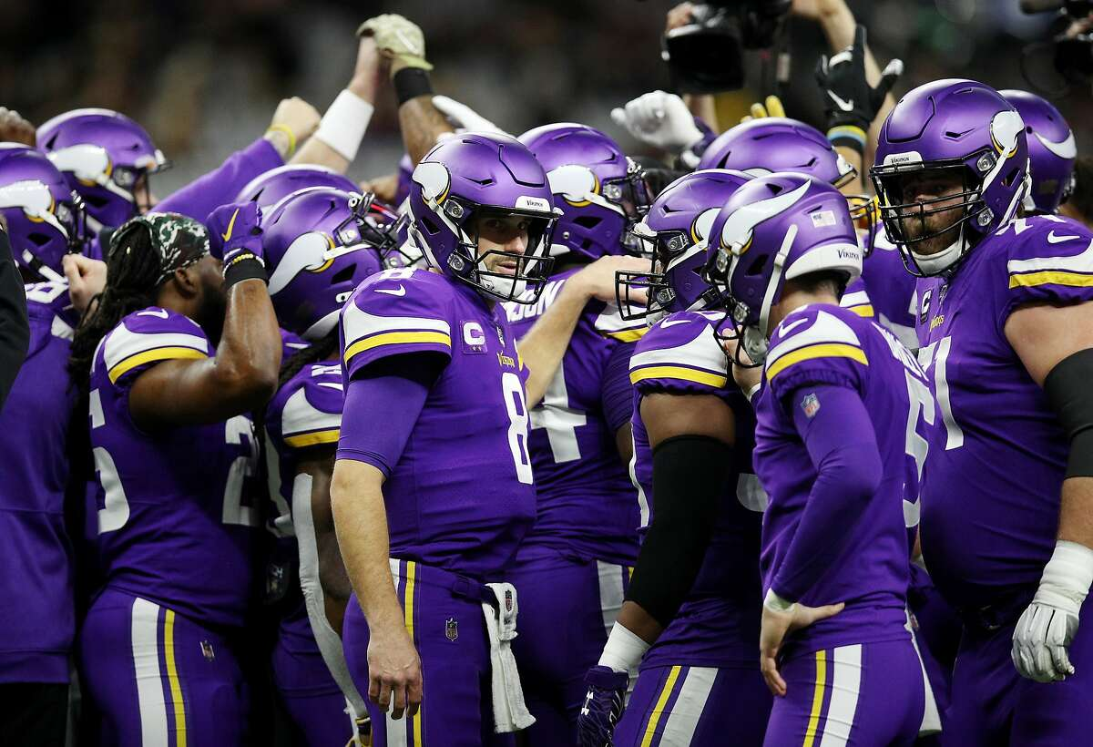 Kirk Cousins #8 of the Minnesota Vikings huddles with teammates before the NFC Wild Card Playoff game against the New Orleans Saints at Mercedes Benz Superdome on January 05, 2020 in New Orleans, Louisiana.