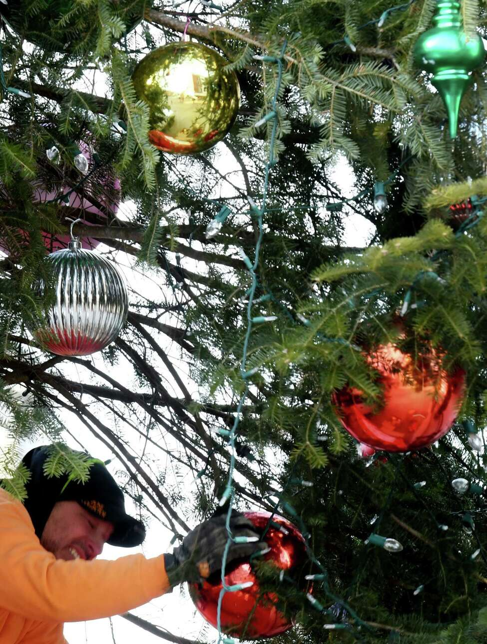 Christmas decorations are taken down by Schenectady city workers on Thursday, Jan. 9, 2020, on State Street in Schenectady, N.Y. (Will Waldron/Times Union)