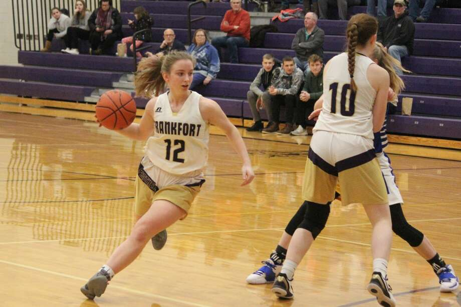 Haley Myers dribbles around a screen set by Madi Odette. Frankfort coach Tim Reznich has raved about Myers' play at point guard this year. Photo: Robert Myers