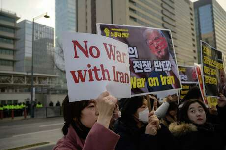 Anti-war activists hold a rally outside the US embassy calling for a de-escalation of tensions between the United States and Iran, in Seoul on Thursday.