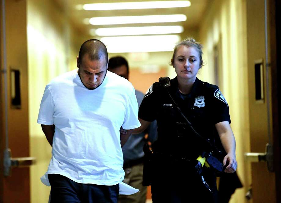 Jose Sanchez Davila, 39, accused of trafficking his wife, who is now his ex-wife, is led from Public Safety Headquarters on Thursday, Jan. 9, 2019. Photo: Billy Calzada, Staff Photographer / ***MANDATORY CREDIT FOR PHOTOG AND SAN ANTONIO EXPRESS-NEWS /NO SALES/MAGS OUT/TV