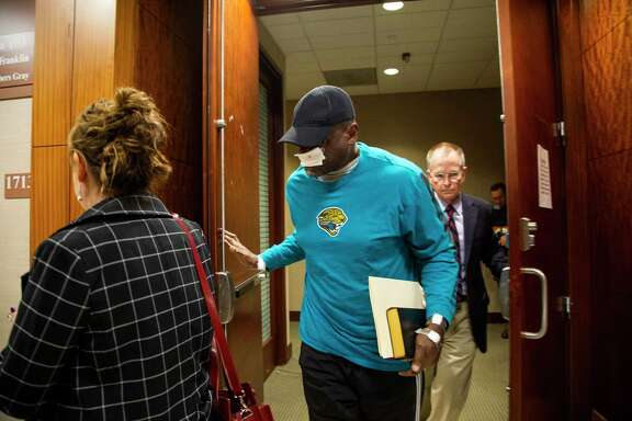 Former Houston police officer Gerald Goines, center, exits the 338th District Criminal Court after pleading the Fifth Amendment on Thursday, Jan. 9, 2020, in Houston.
