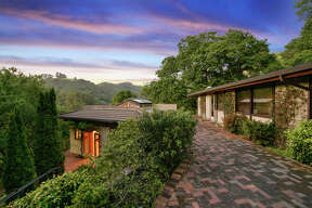 A mini-estate in the hills of Berkeley comes with a wine cellar and a $1.250M price tag