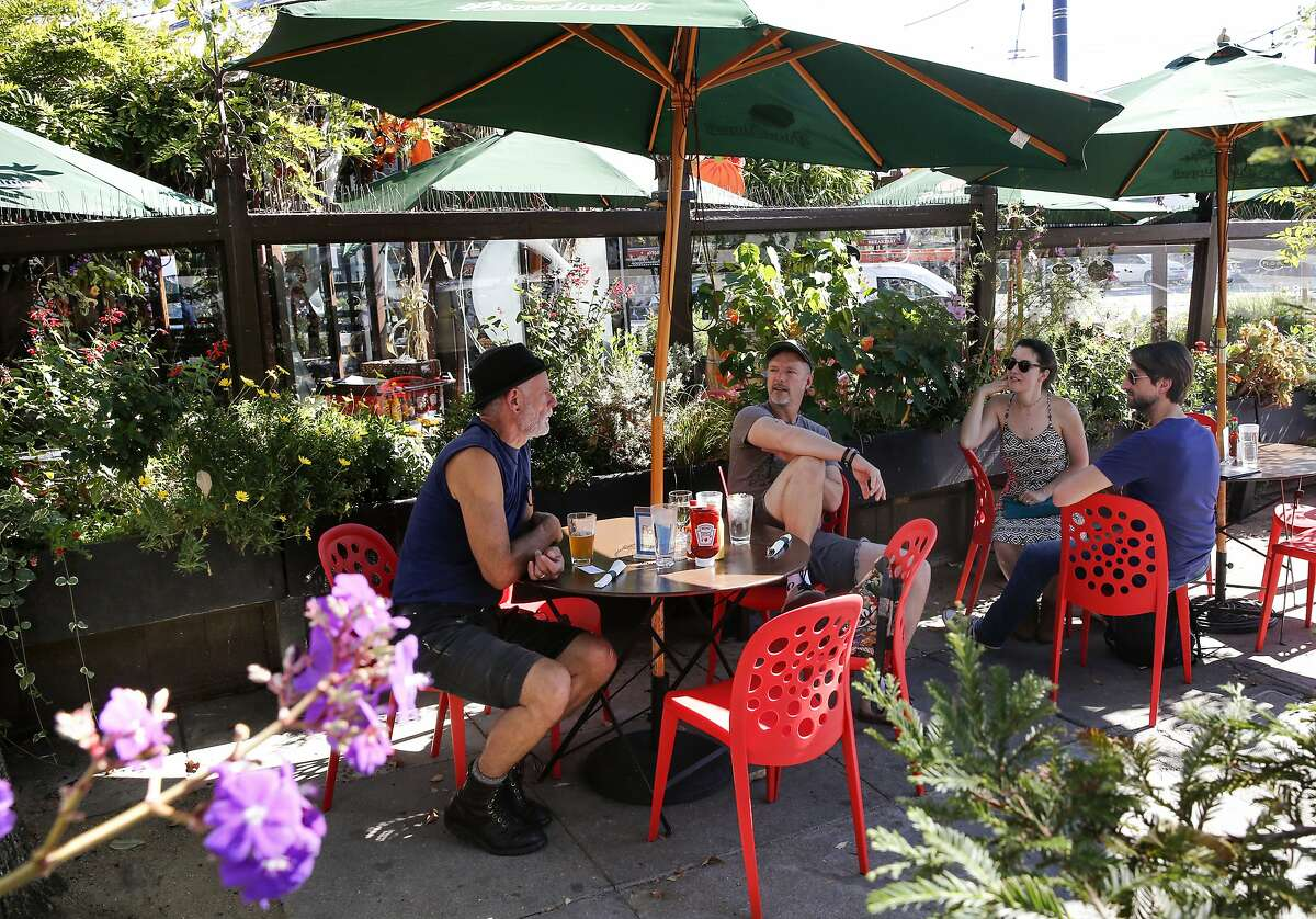 ( l to r ) Mark Stevens, Birch (didn't give his last name), Stephanie Freed and Cory Krug enjoy the sidewalk setting at Cafe Flore in San Francisco, Ca. on Thursday October 26, 2017. Owner Terrance Alan of Cafe Flore, hopes to turn the business in to San Francisco's first cannabis cafe.