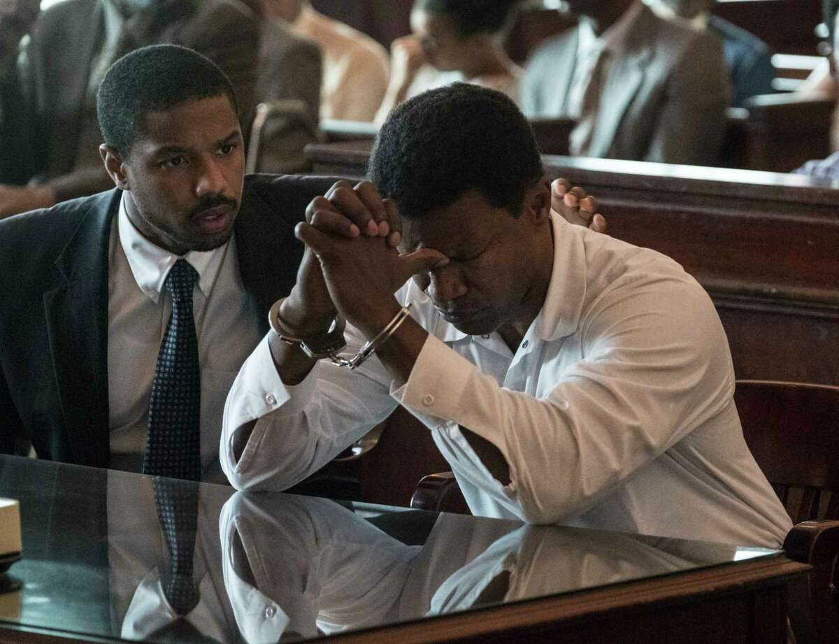 This image released by Warner Bros Pictures shows Michael B. Jordan, left, and Jamie Foxx in a scene from