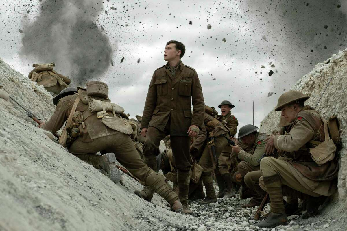 This image released by Universal Pictures shows George MacKay, center, in a scene from