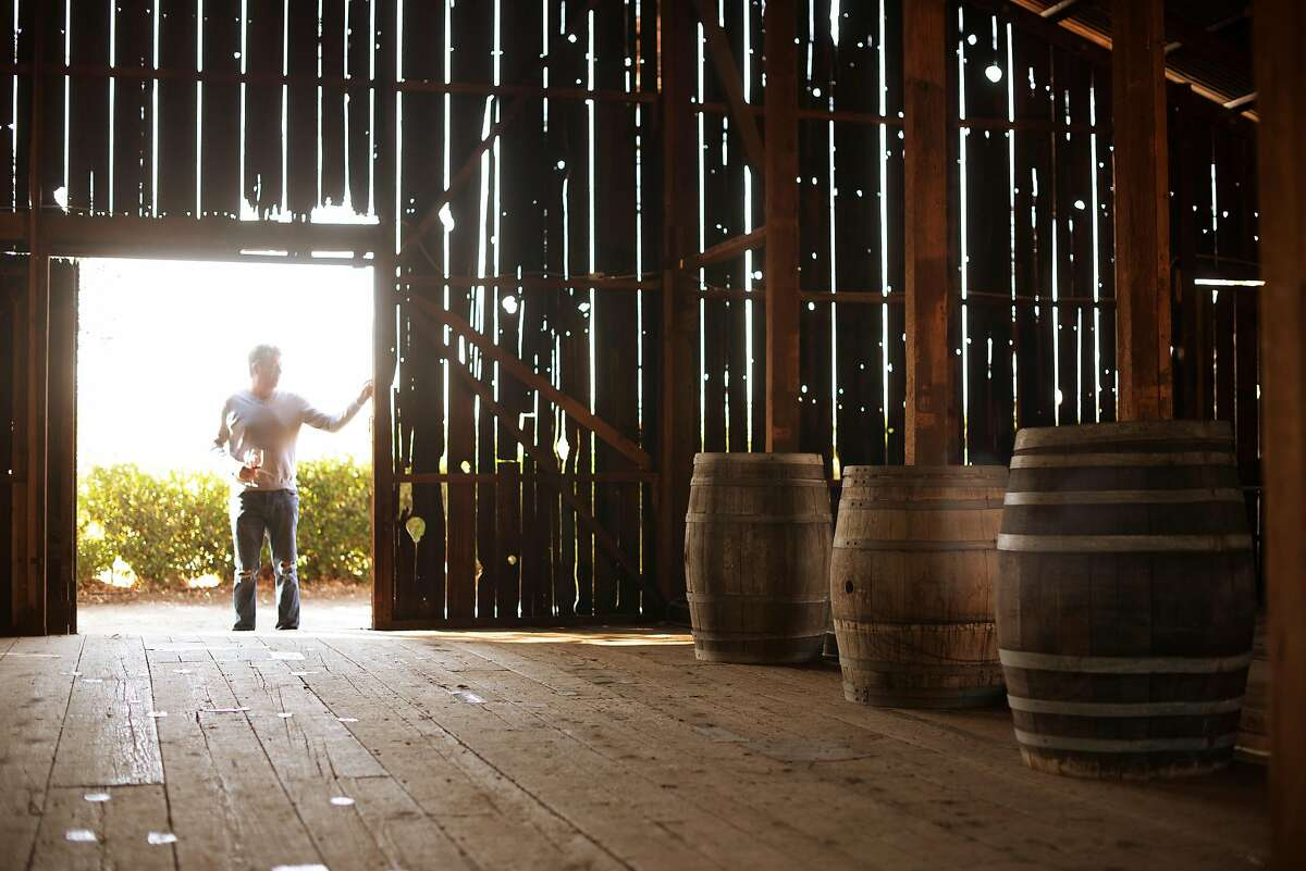 Dean Shellenberger, of Sacramento, looking over the historic barn that survived the Kincade Fire during a visit to the tasting room now open in the barn at Soda Rock Winery in Healdsburg, California. November 10, 2019.