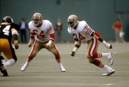 PITTSBURGH, PA - NOVEMBER 1: Defensive end Fred Dean #74 of the San Francisco 49ers pursues the play with linebacker Jack Reynolds #64 against the Pittsburgh Steelers during an NFL football game November 1, 1981 at Three Rivers Stadium in Pittsburgh, Pennsylvania. Dean played for the 49ers from 1981-1985. (Photo by Focus on Sport/Getty Images)