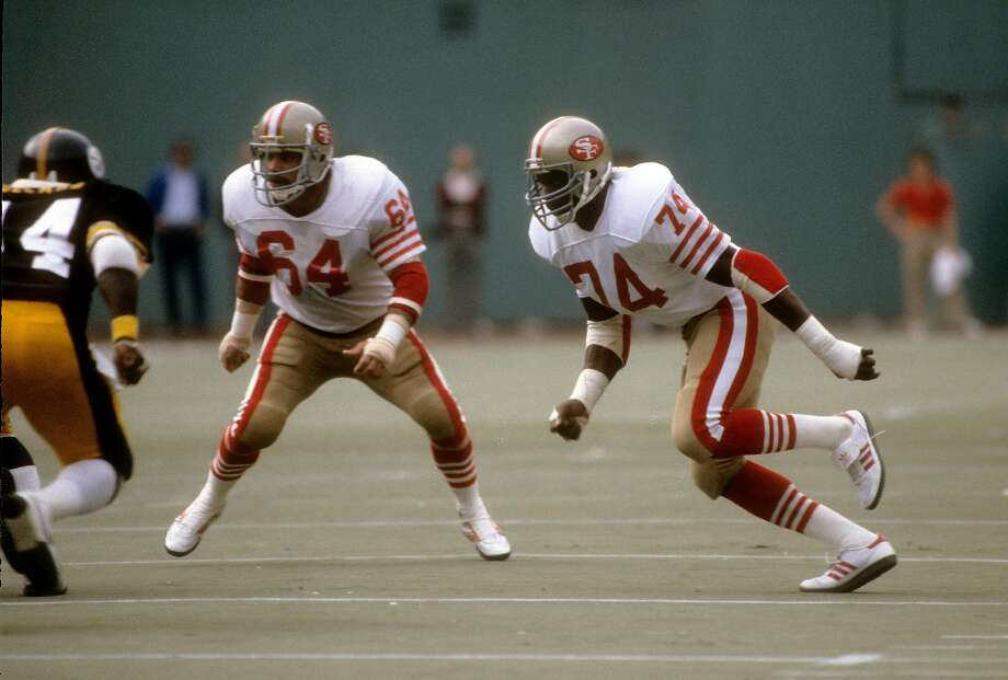 Defensive end Fred Dean #74 of the San Francisco 49ers pursues the play with linebacker Jack Reynolds #64 against the Pittsburgh Steelers during an NFL football game November 1, 1981 at Three Rivers Stadium in Pittsburgh, Pennsylvania. Dean played for the 49ers from 1981-1985. Photo: Focus On Sport / Getty Images
