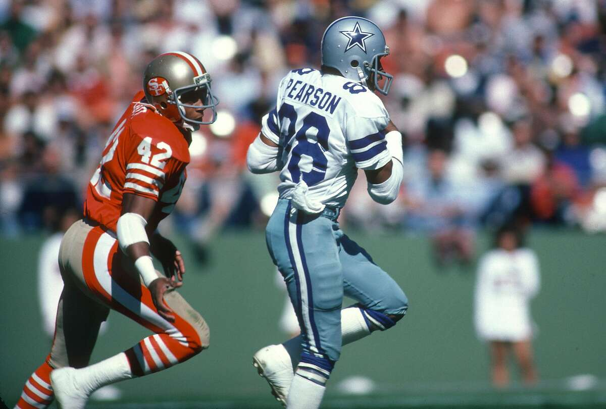 SAN FRANCISCO, CA - OCTOBER 11: Wide Receiver Drew Pearson #88 of the Dallas Cowboys runs with the ball, pursued by Ronnie Lott #42 of the San Francisco 49ers during an NFL football October 11, 1981 at Candlestick Park in San Francisco, California. Pears