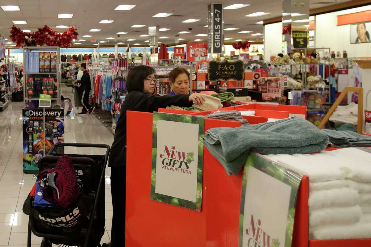 FILE - In this Nov. 29, 2019, file photo customers shop at a Kohl's store in Colma, Calif. Mall-based retailers J.C. Penney, Kohl's and Victoria's Secret parent reported sales declines for the holiday season, underscoring continued challenges ahead from online rivals. (AP Photo/Jeff Chiu, File)