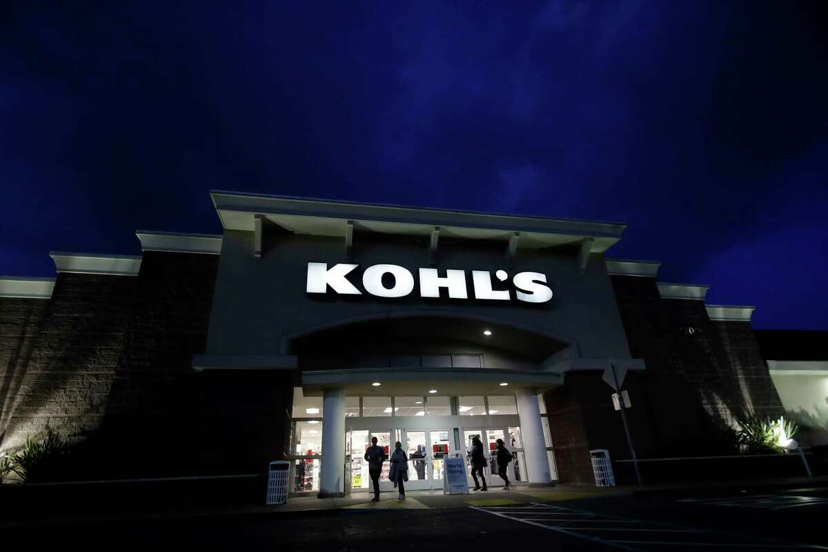 FILE - In this Nov. 29, 2019, file photo customers walk outside of a Kohl's store in Colma, Calif. Mall-based retailers J.C. Penney, Kohl's and Victoria's Secret parent reported sales declines for the holiday season, underscoring continued challenges ahead from online rivals. (AP Photo/Jeff Chiu, File)